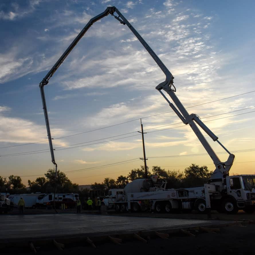 A concrete pump pouring concrete for a storage center slab