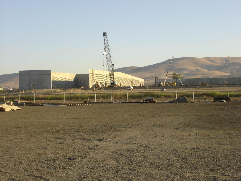 Crane lifting concrete tilt panels